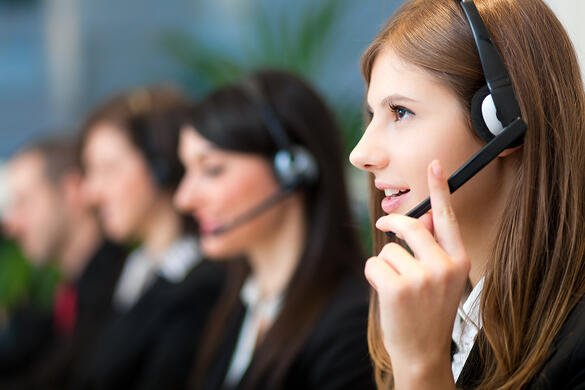 Woman answering customer phone call at a call center